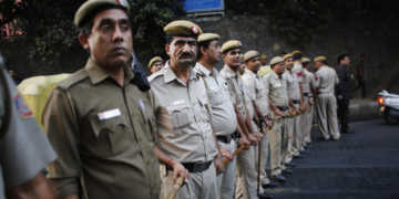 Indian policemen form a human barricade to prevent supporters of the 'Kiss of Love' campaign from marching towards the headquarters of the Hindu nationalist organization Rashtriya Swayamsevak Sangh's (RSS) in New Delhi, India, Saturday, Nov. 8, 2014. The campaign was launched to protest alleged increase in moral policing by Hindu right-wing organizations in India. (AP Photo/Altaf Qadri)